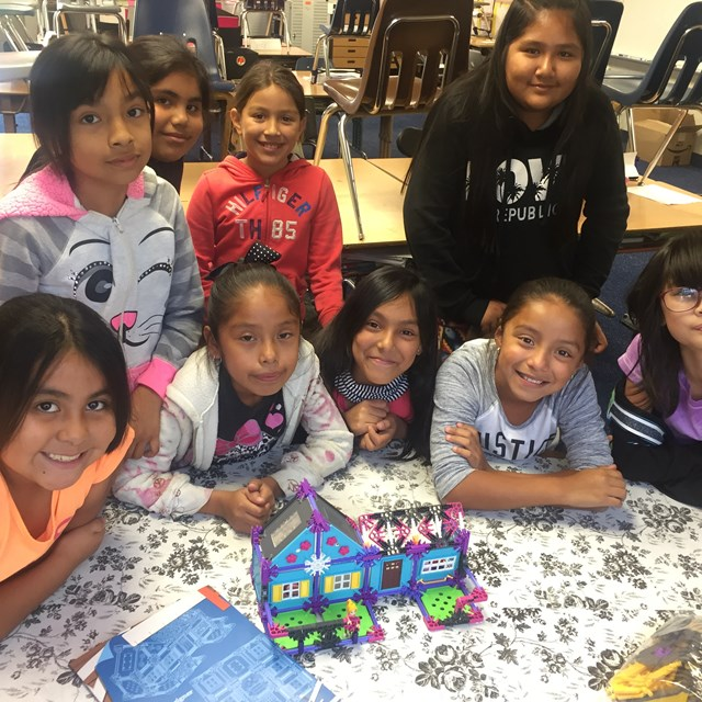 Students smile after completing their model house!
