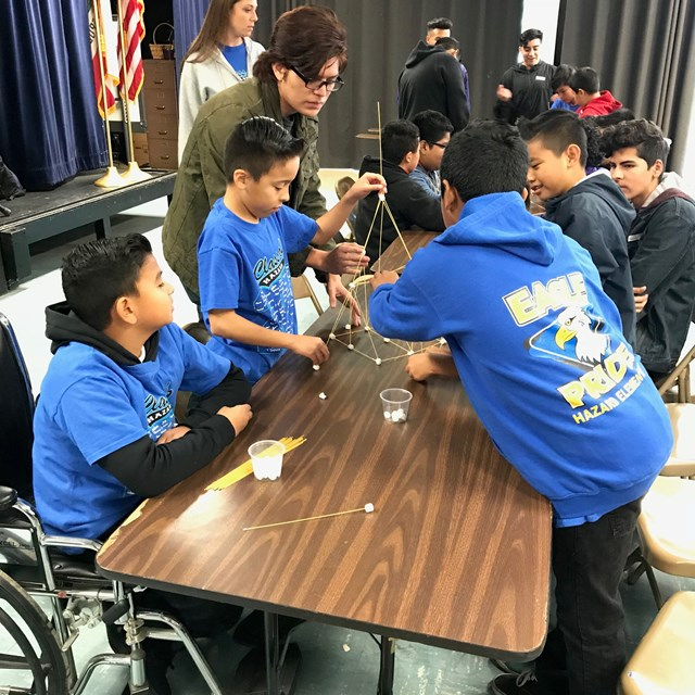 Hazard scholars work side-by-side with Santiago High School's students to complete their engineering projects.