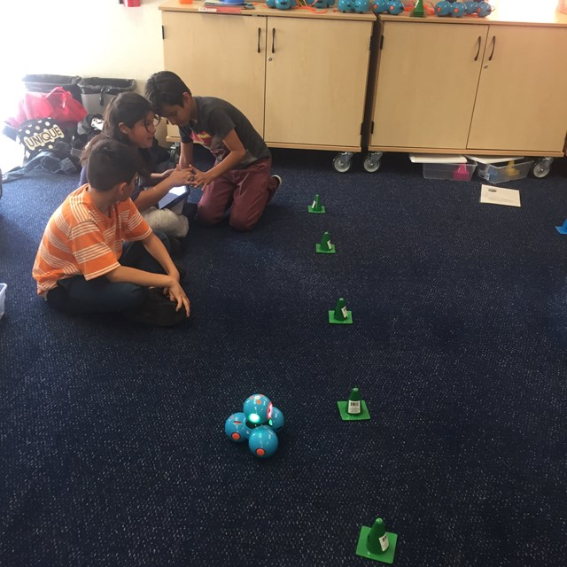 Our team of future computer scientists work on hands-on projects with Sphero and Clash Robots!