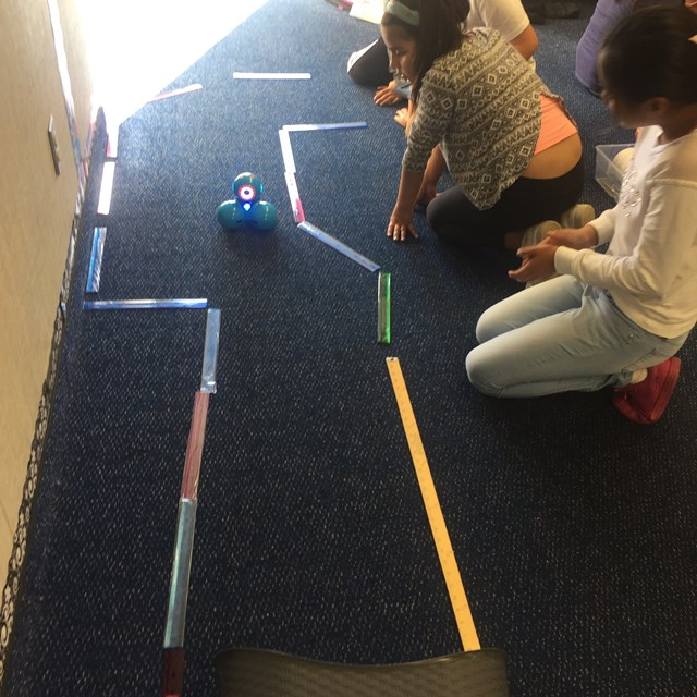 Our students master the precision that it takes to navigate the robots through a trail.